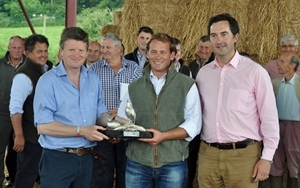 Mr John Phillips (centre) from Fairford in Gloucestershire, who has gone that extra mile for wildlife on his organic farm is pictured receiving his silver Grey Partridge Trophy from former winner of the trophy Mr Richard Benyon MP (left) and Mark Tuffnell (right) sponsor of the trophy and Chairman of the Cotswold Grey Partridge Group