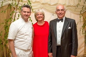 Renowned gourmet chef Colin McGurran (left) with hosts Julia and Chris Butterfield. Photocredit: Jason Glenn.